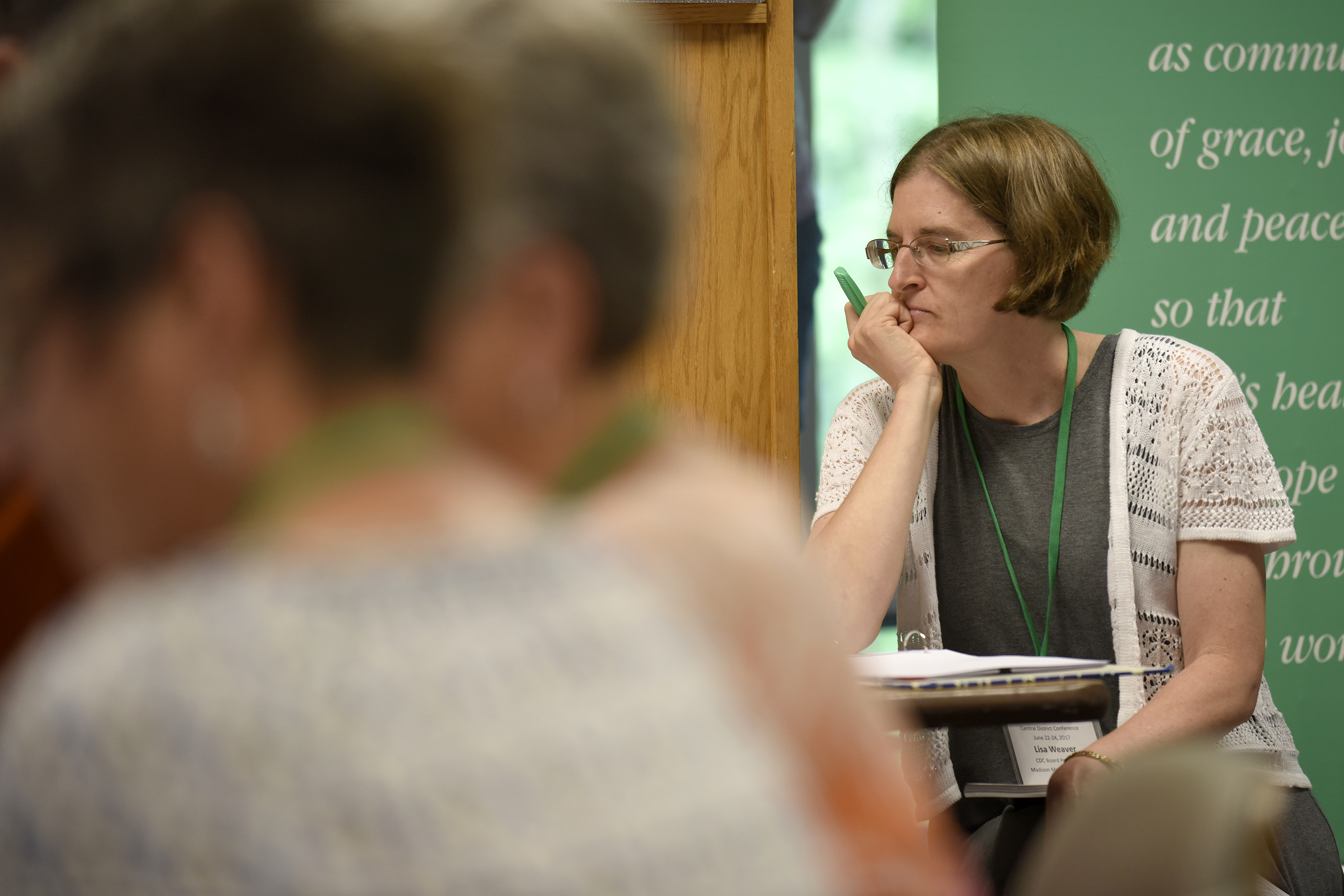 Central District Conference president Lisa Weaver listens during Friday morning sessions at Central District Conference, Friday, June 23, 2017, at Bluffton University, Bluffton, OH. Weaver ended her two-year term as president at the end of the meeting. Photograph by J. Tyler Klassen