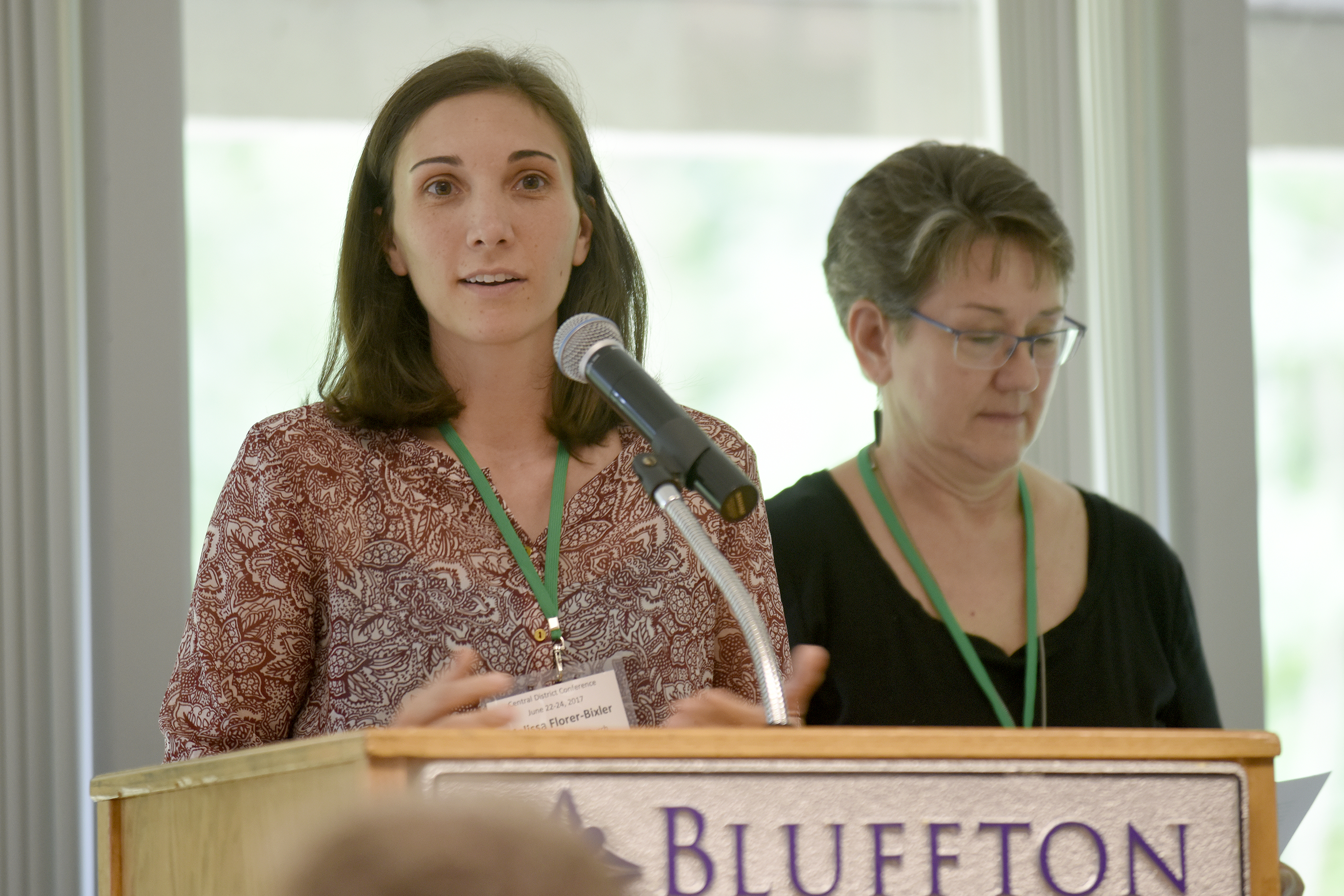 Melissa Florer Bixler (left) and Brenda North Martin introduce the Raleigh congregation during Friday morning sessions at Central District Conference, Friday, June 23, 2017, at Bluffton University, Bluffton, OH. Photograph by J. Tyler Klassen