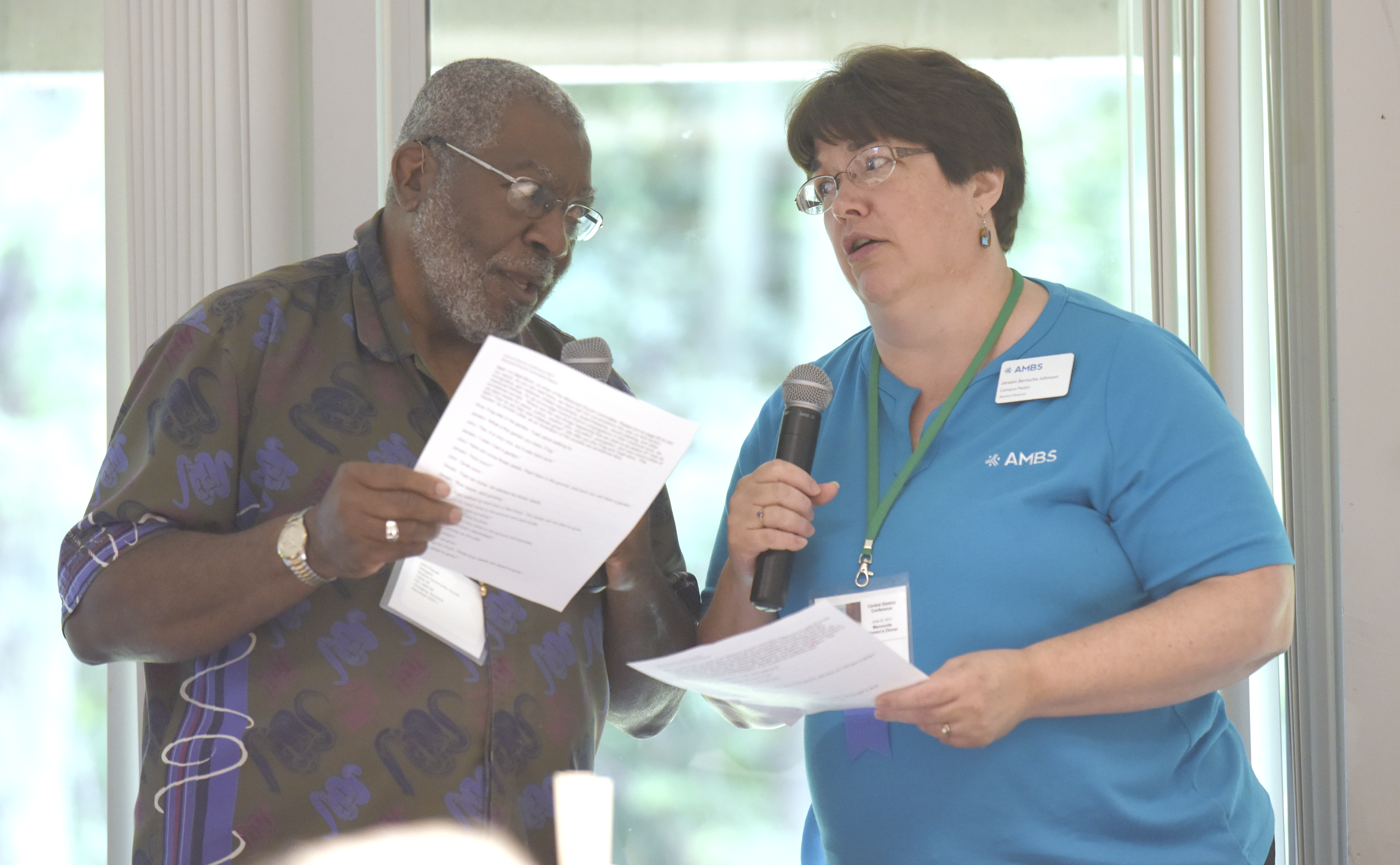John Powell (left) and Janeen Bertsche Johnson take part in a Frog and Toad story as a way of reporting on the Missional Church Committee report for 2017, during Friday morning sessions at Central District Conference, Friday, June 23, 2017, at Bluffton University, Bluffton, OH. Bertsche Johnson attends Eighth Street, Goshen and Powell attends Shalom, Ann Arbor. Photograph by J. Tyler Klassen