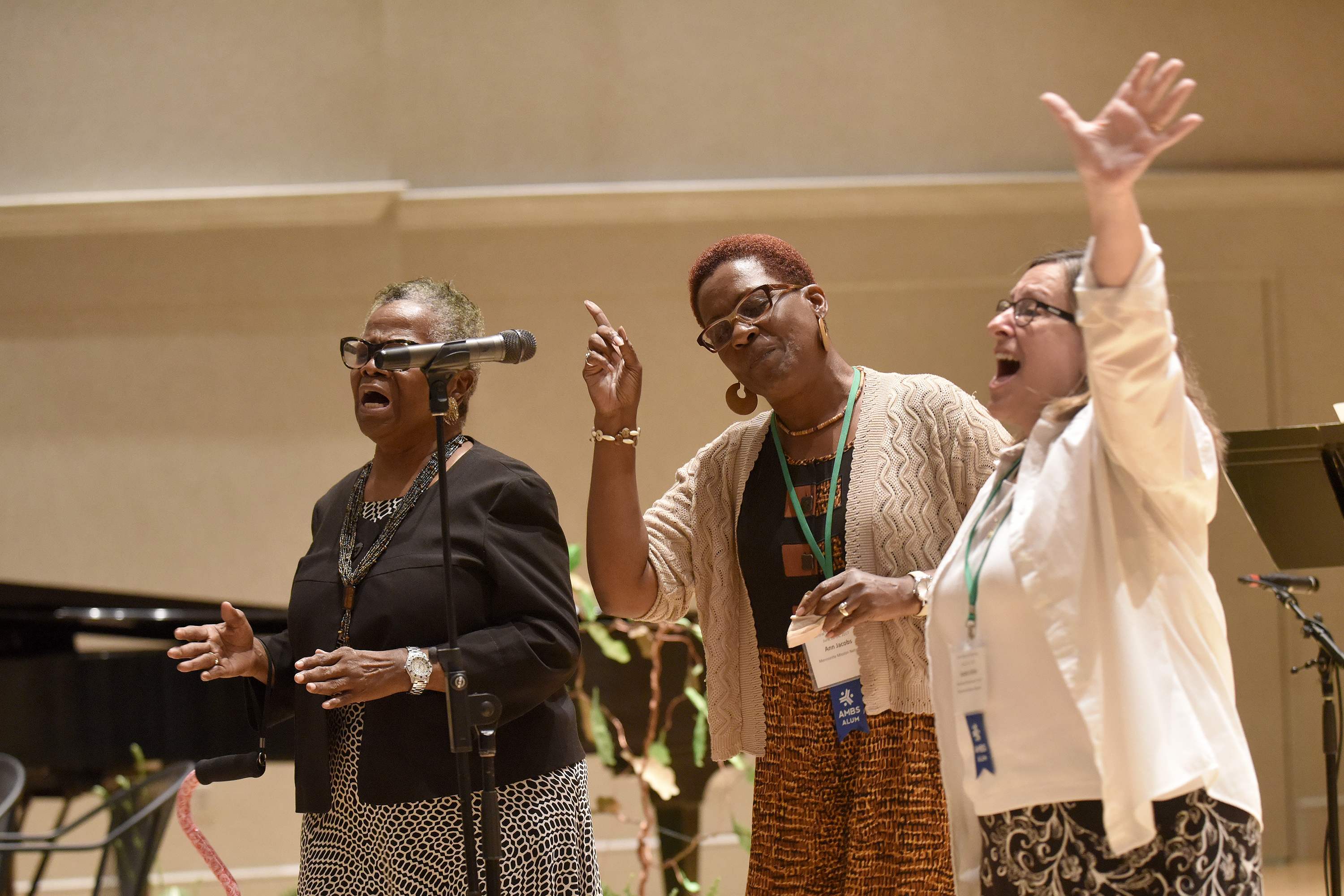 Work in Progress sings during the Friday night worship at Central District Conference, Friday, June 23, 2017, at Bluffton University, Bluffton, OH. Work in Progress is (from left) Lefuarn Harvey, Ann Jacobs and Sandy Miller. All three work at Mennonite Mission Network. Photograph by J. Tyler Klassen