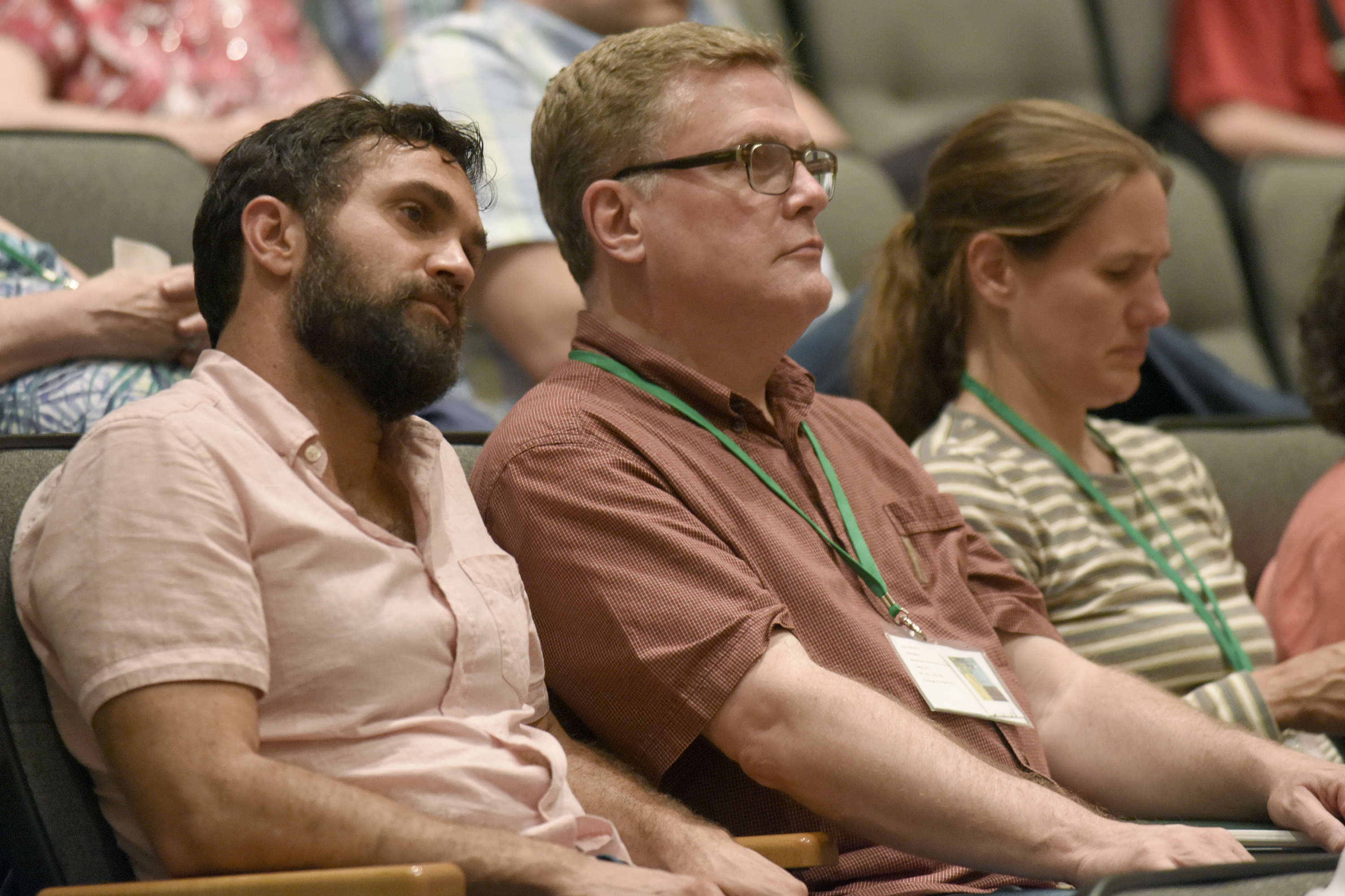 Isaac Villegas (left) and Ron Adams listen to the Friday evening worship at Yoder Recital Hall,  during the Central District Conference, Friday, June 23, 2017, at Bluffton University, Bluffton, OH. Villegas is the pastor at Chapel Hill Mennonite Fellowship and Adams pastors Madison Mennonite Church. Photograph by J. Tyler Klassen
