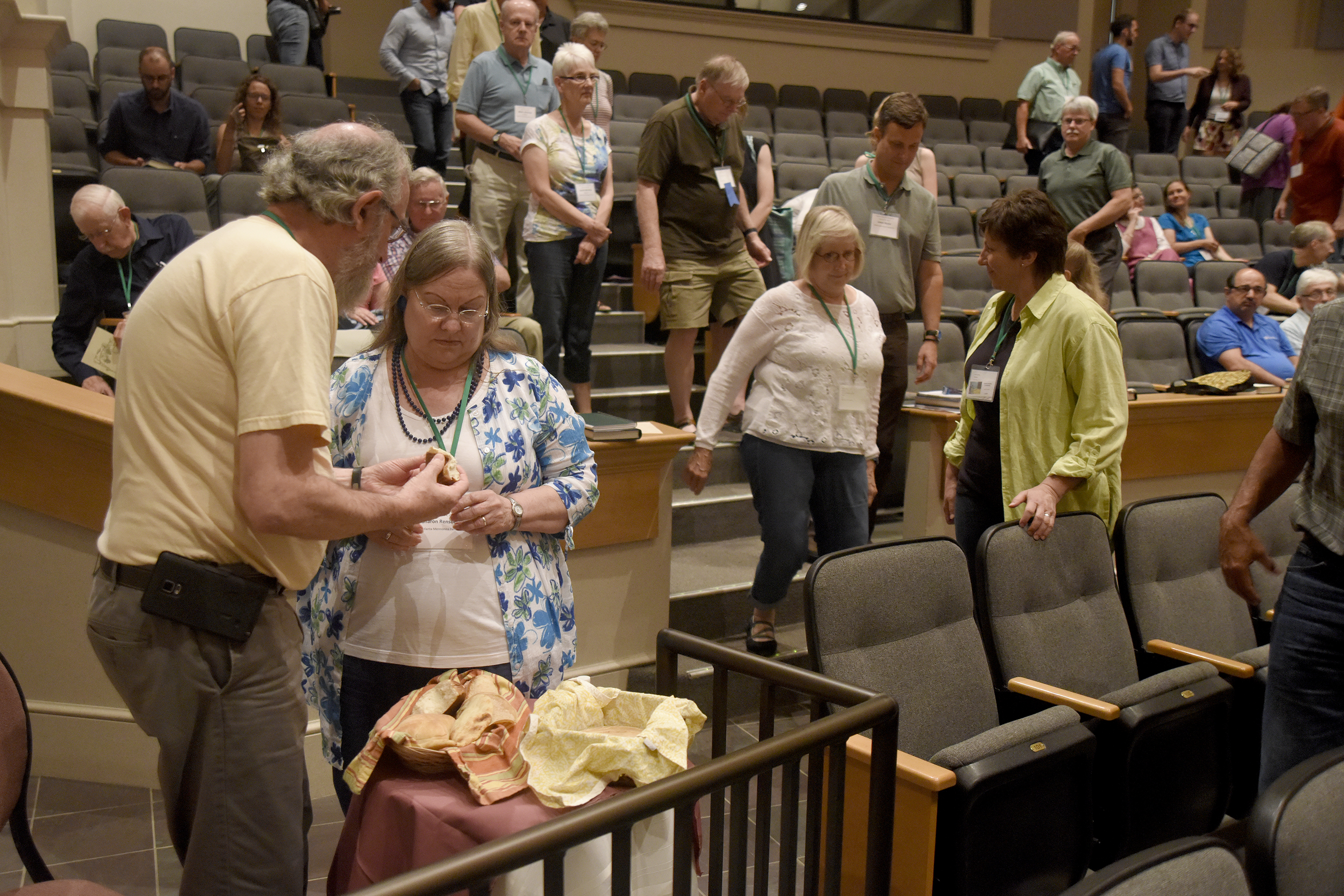 Participants take communion bread during the Saturday morning worship service in Yoder Recital Hall during the Central District Conference, Friday, June 23, 2017, at Bluffton University, Bluffton, OH. Photograph by J. Tyler Klassen