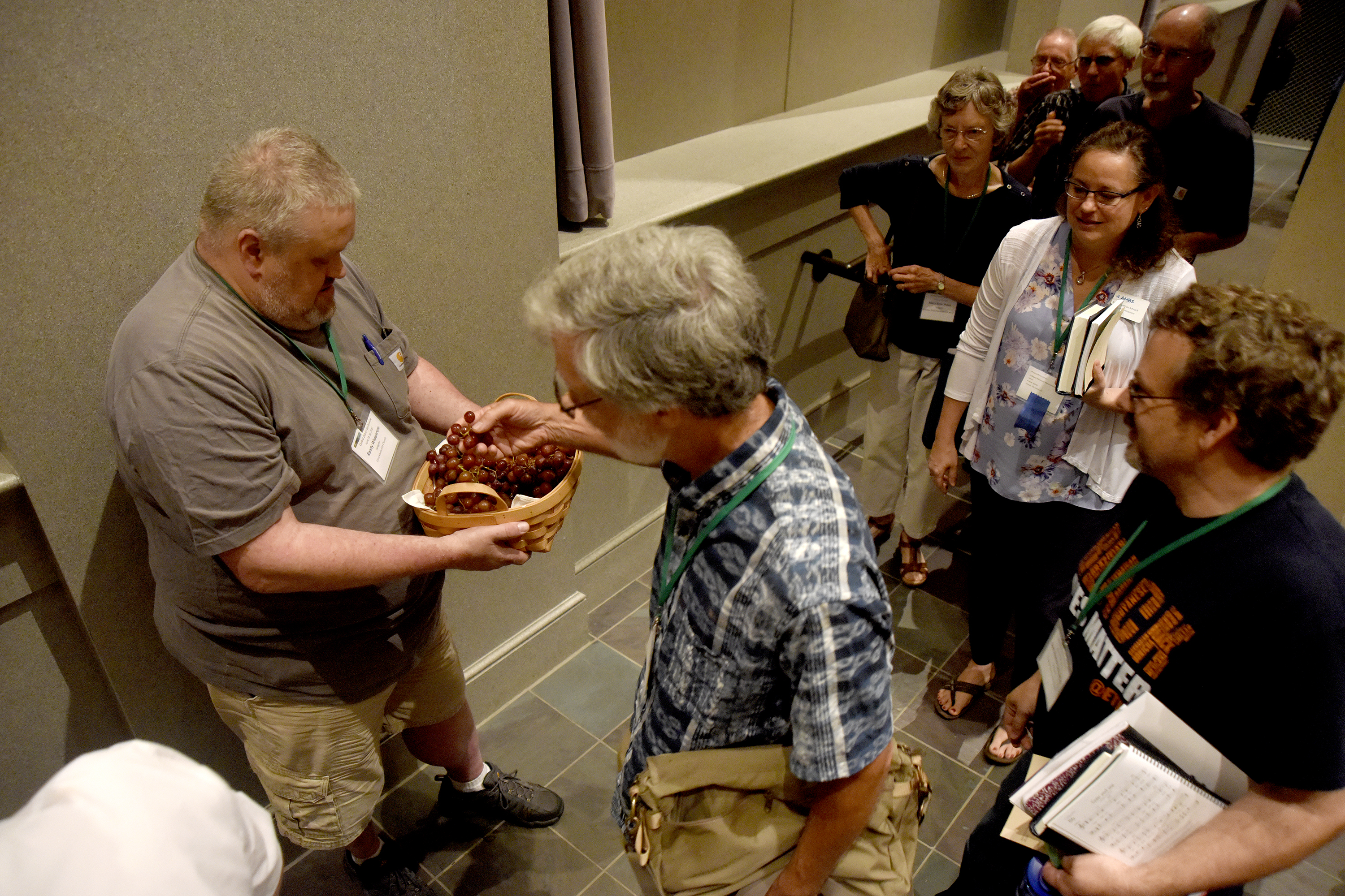 Randy Wapperom (left) serves Phil Hart grapes during communion at Yoder Recital Hall during the Central District Conference, Friday, June 23, 2017, at Bluffton University, Bluffton, OH. Wapperom attends Lima Mennonite Church and Mason attends Columbus Mennonite Church. Photograph by J. Tyler Klassen