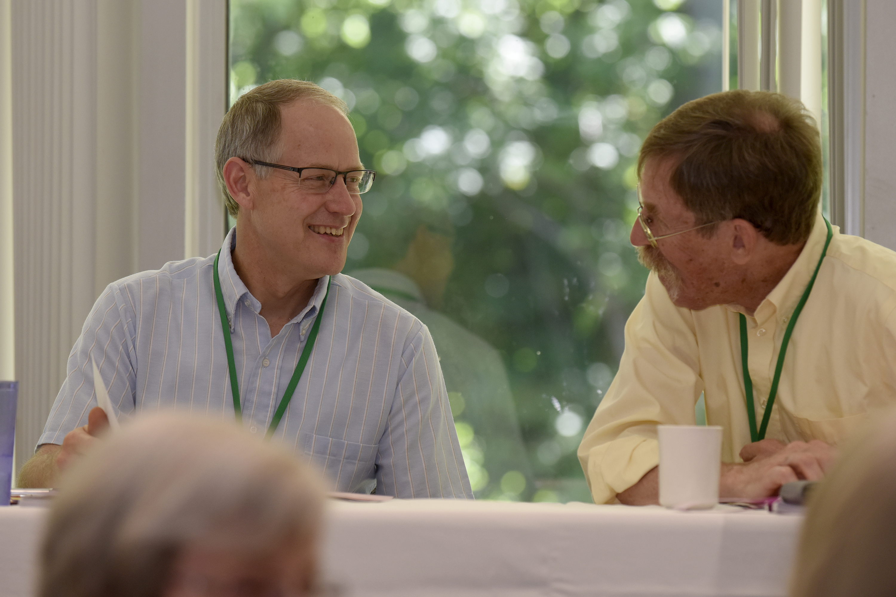 Central District conference minister Doug Luginbill (left) and Arman Habegger talk during the Saturday morning session during the Central District Conference, Friday, June 23, 2017, at Bluffton University, Bluffton, OH. Habegger is the incoming CDC president. Photograph by J. Tyler Klassen