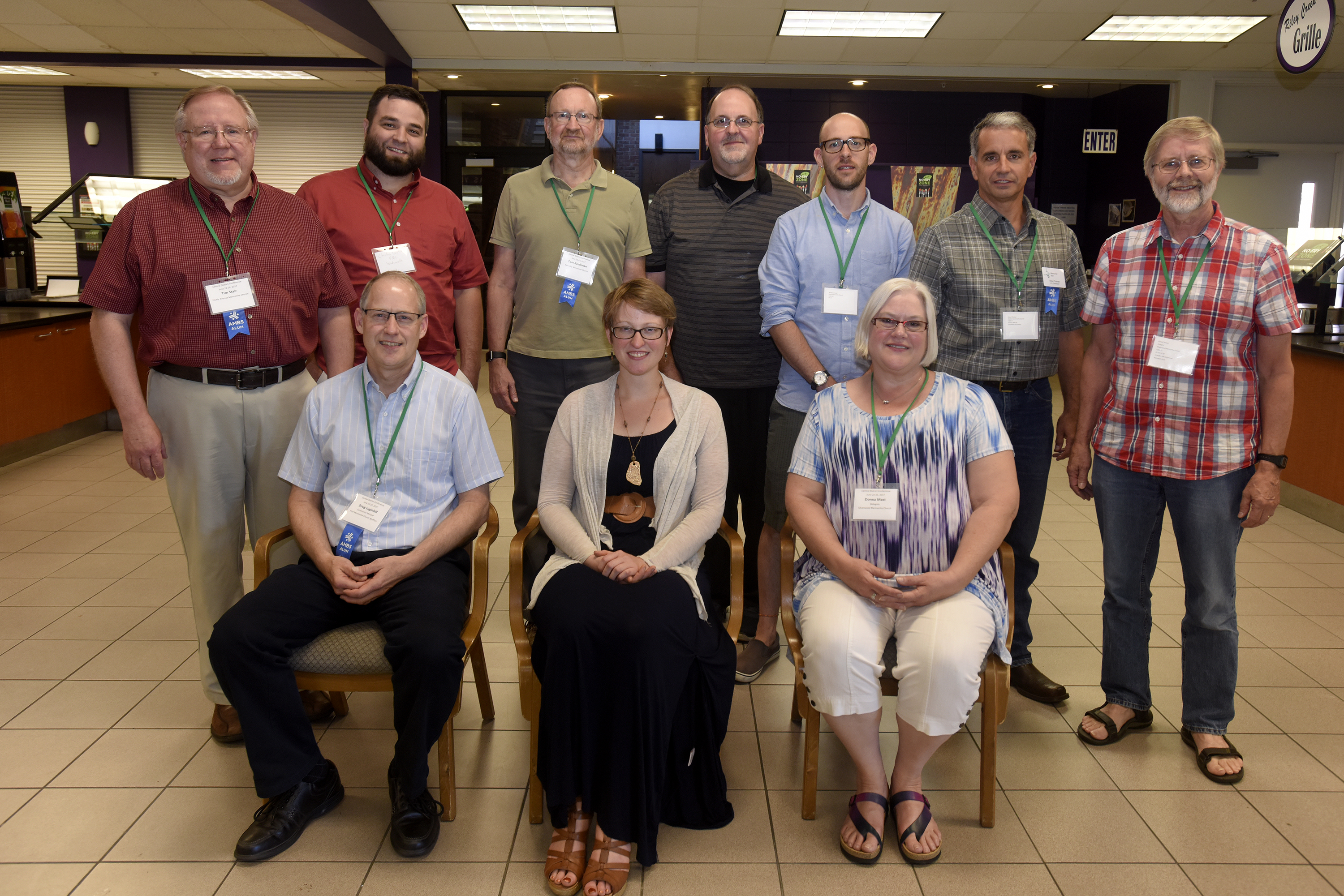 Pastors credentialed or installed during the previous year were recognized at the end of Central District Conference, Friday, June 23, 2017, at Bluffton University, Bluffton, OH. From left front row are: Doug Luginbill, Emily Hedrick, and Donna Mast. Row two from left: Tim Stair, Charles Bontrager, Tom Kauffman, Michael Gehrman, Matthew Yoder, Steve Thomas, and Russell Jensen.  Photograph by J. Tyler Klassen